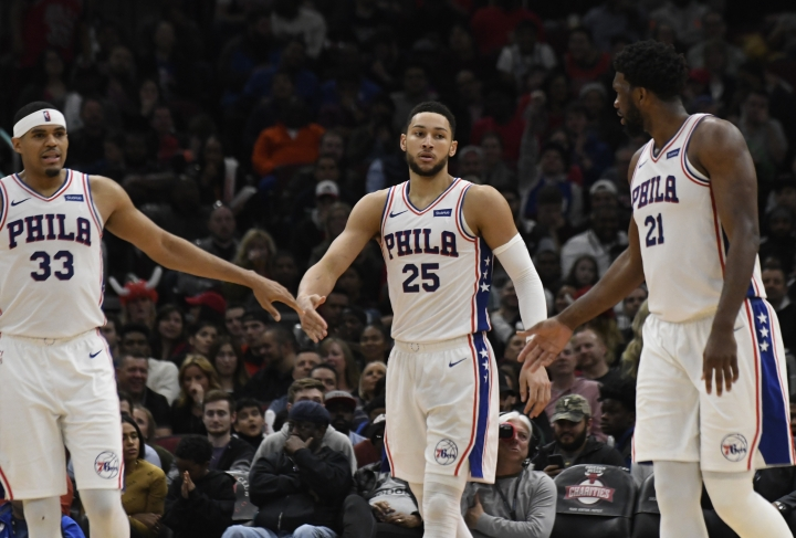 Philadelphia 76ers guard Ben Simmons (25) walks between forward Tobias Harris (33) and center Joel Embiid (21) after making a basket against the Chicago Bulls during the second half of an NBA basketball game Saturday, April 6, 2019, in Chicago. (AP Photo/David Banks)