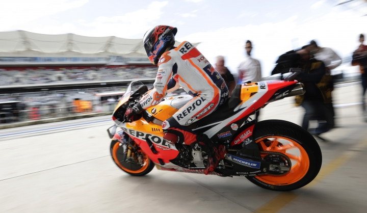 Marc Marquez (93), of Spain, speeds out of the garage after a pit stop during a final practice session for the Grand Prix of the Americas motorcycle race at the Circuit Of The Americas, Saturday, April 13, 2019, in Austin, Texas. (AP Photo/Eric Gay)