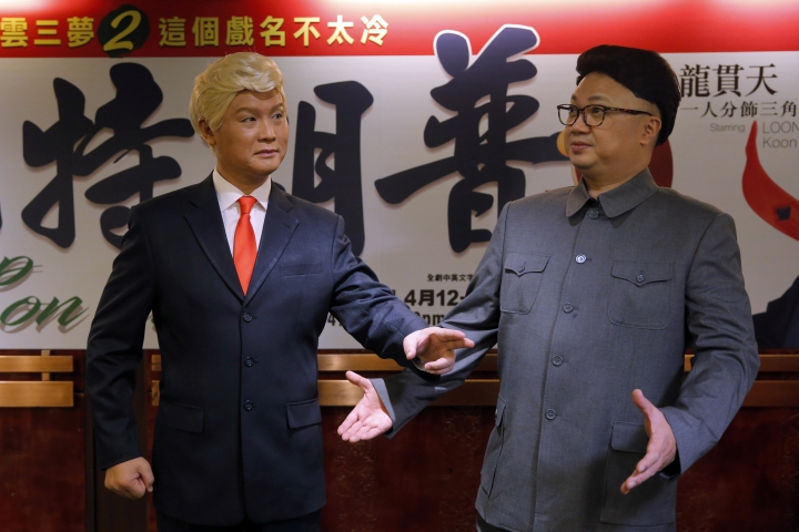 "FILE - In this March 1, 2019, file photo, Hong Kong actors Chan Hung-chun, right, and Lung Koon-tin, dressed as North Korean leader Kim Jong Un and U.S. President Donald Trump, pose during a press conference to promote their upcoming Chinese opera ""Trump on Show"" in Hong Kong. President Trump is the inspiration for ""Trump on Show,"" a four-day Cantonese opera that reimagines the president's personal life and his fictional twin brother who lives in China. (AP Photo/Kin Cheung, File)"