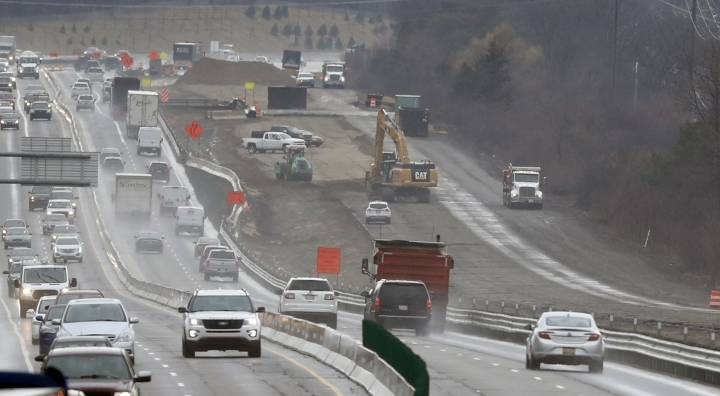 In a Friday, April 12, 2019 photo, Interstate Highway 75 construction continues in Troy, Mich. After passing waves of tax cuts in recent years, some Republican-dominated states have decided it's time to make a big exception, calling for tax increases to fix roads crumbling from years of low funding and deferred maintenance. (AP Photo/Carlos Osorio)