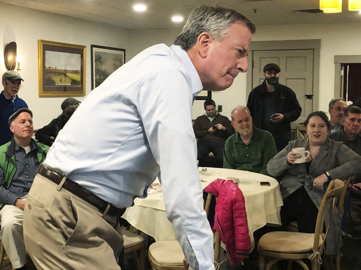 FILE - This March 17, 2019 file photo shows New York Mayor Bill de Blasio listening as he speaks before a group of people at a restaurant in Concord, N.H. A would-be progressive standard bearer, de Blasio has spent the past few months exploring a run, traveling to events in early primary states. (AP Photo/Hunter Woodall)
