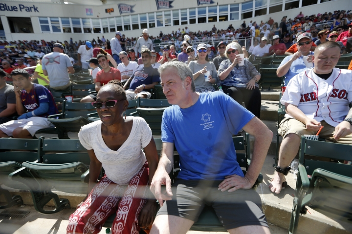 FILE - This March 2, 2019 file photo shows New York City Mayor Bill de Blasio and his wife Chirlane McCray between innings of a spring training baseball game between the Boston Red Sox and the Baltimore Orioles in Fort Myers, Fla. A would-be progressive standard bearer, Bill de Blasio has spent the past few months exploring a run, traveling to events in early primary states. (AP Photo/Gerald Herbert, File)
