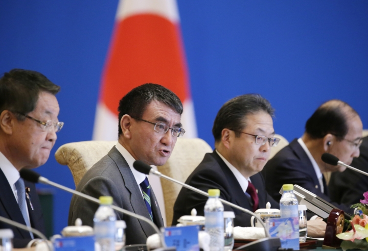 "Japanese Foreign Minister Taro Kono speaks at the Japan-China high level economic dialogue with China's Foreign Minister Wang Yi at Diaoyutai State Guesthouse in Beijing, China, Sunday, April 14, 2019. Kono says China and Japan have the opportunity to ""take charge of the economic field"" during a time of worldwide uncertainty.(Jason Lee/Pool Photo via AP)"