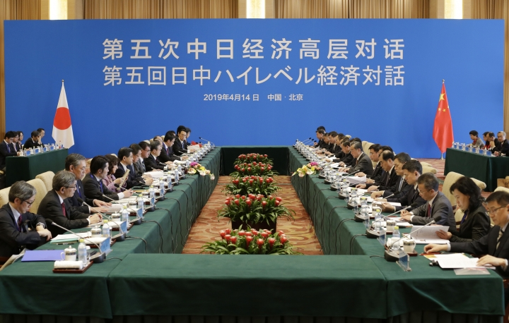 Japanese Foreign Minister Taro Kono, eight from left, and China's Foreign Minister Wang Yi, ninth from right, attend the Japan-China high level economic dialogue at Diaoyutai State Guesthouse in Beijing, China, Sunday, April 14, 2019.(Jason Lee/Pool Photo via AP)