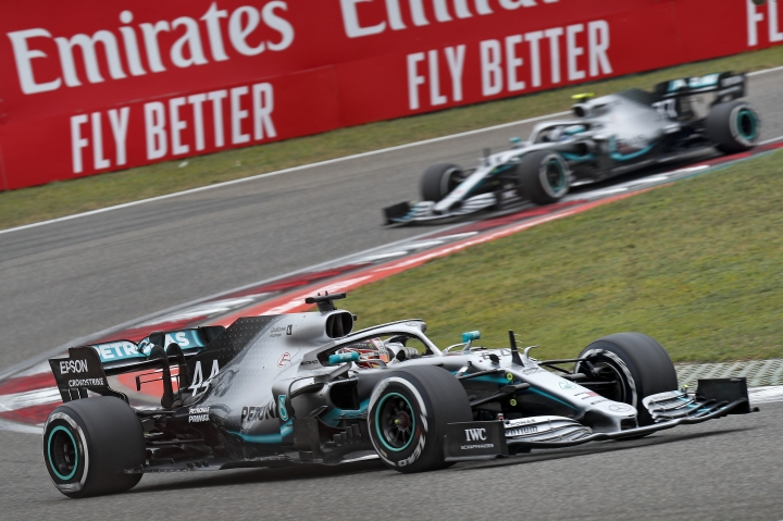 Mercedes driver Lewis Hamilton of Britain steers his car ahead of his teammate Valtteri Bottas of Finland during the Chinese Formula One Grand Prix at the Shanghai International Circuit in Shanghai, Sunday, April 14, 2019. (AP Photo/Andy Wong)