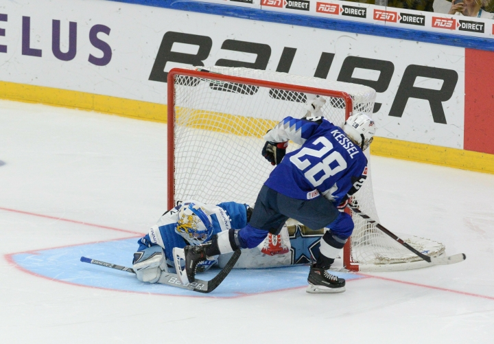 Amanda Kessel of the United States scores a shootout goal past goalkeeper Noora R'ty of Finland during the IIHF Women's Ice Hockey World Championships final match between the United States and Finland in Espoo, Finland, on Sunday, April 14, 2019. (Mikko Stig/Lehtikuva via AP)