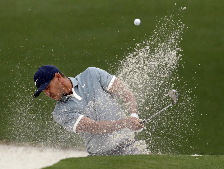 Brooks Koepka hits from a bunker on the 10th hole during the final round for the Masters golf tournament, Sunday, April 14, 2019, in Augusta, Ga. (AP Photo/Charlie Riedel)