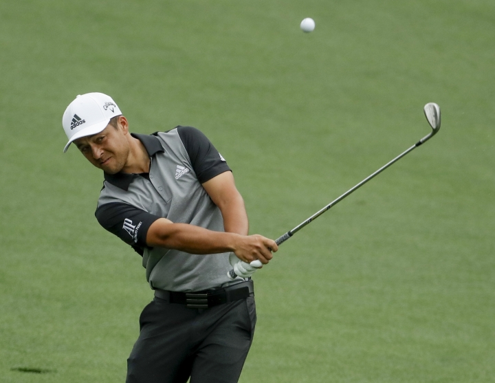 Xander Schauffele hits on the second hole during the final round for the Masters golf tournament Sunday, April 14, 2019, in Augusta, Ga. (AP Photo/Chris Carlson)