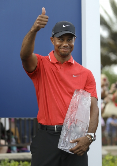 FILE - In this May 12, 2013, file photo, Tiger Woods gives a thumbs-up as he holds the trophy after winning The Players Championship golf tournament at TPC Sawgrass in Ponte Vedra Beach, Fla. Woods completes an amazing journey by winning the 2019 Masters, overcoming 11 years of personal foibles and professional pain that seemed likely to be his lasting legacy. (AP Photo/John Raoux, File)