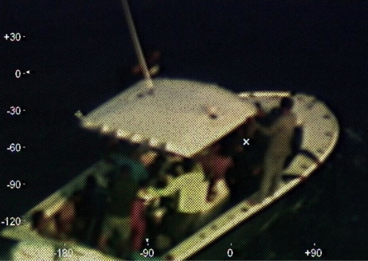 In this photo provided by the Coast Guard, a Coast Guard Air Station Miami HC-144 Ocean Sentry aircrew takes a photo of a disabled vessel that the aircrew located 130 nautical miles (210 kilometers) off Mexico's Yucatan Peninsula on Sunday, April 14, 2019. The U.S. Coast Guard said it worked with a cruise ship to rescue 23 people adrift for days in the Gulf of Mexico. (Petty Officer 3rd Class Brandon Giles/U.S. Coast Guard via AP)