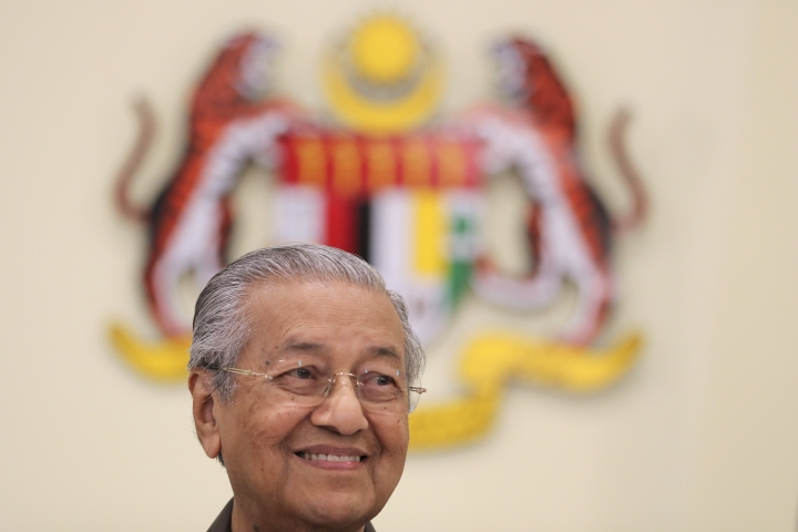 Malaysian Prime Minister Mahathir Mohamad smiles during a press conference in Putrajaya, Malaysia, Monday, April 15, 2019. Malaysia's government decided to resume a China-backed rail link project, after the Chinese contractor agreed to cut the construction cost by one-third. (AP Photo/Vincent Thian)