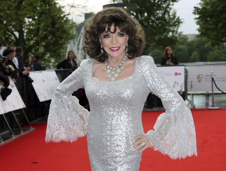 """FILE - In this Sunday, May 14, 2017 file photo, Joan Collins poses for photographers upon arrival to the British Academy Television Awards at the Royal Festival Hall in London. Joan Collins has thanked firefighters for their quick response after a blaze erupted in her London apartment. The 85-year-old actress on Monday, April 15, 2019 shared video images of a charred wall on social media after the weekend fire. She also tweeted thanks to the """"marvelous"""" firefighters who tackled the """"terrifying"""" blaze. (Photo by Joel Ryan/Invision/AP, file)"""