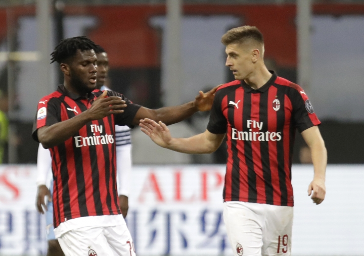 AC Milan's Franck Kessie, left, celebrates after scoring the opening goal with his teammate Krzysztof Piatek during the Serie A soccer match between AC Milan and Lazio, at the San Siro stadium in Milan, Italy, Saturday, April 13, 2019. (AP Photo/Luca Bruno)