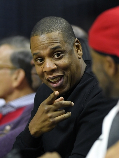 FILE - In this Dec. 7, 2016 file photo, rapper Jay-Z appears at a NBA basketball game between the Los Angeles Clippers and the Golden State Warriors in Los Angeles. Jay-Z will help re-open the newly renovated Webster Hall concert venue in New York City with a performance next week. Tickets for the April 26 show go on sale Friday, April 19, 2019. (AP Photo/Mark J. Terrill, File)