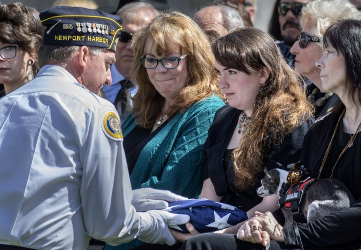 The granddaughter of Edward Nixon, Jill Matheny, is presented the flag during a memorial service in Yorba Linda, Calif., Sunday, April 14, 2019. Nixon, the youngest and last surviving brother of President Richard Nixon, died on Feb. 27. (Mindy Schauer/The Orange County Register via AP)