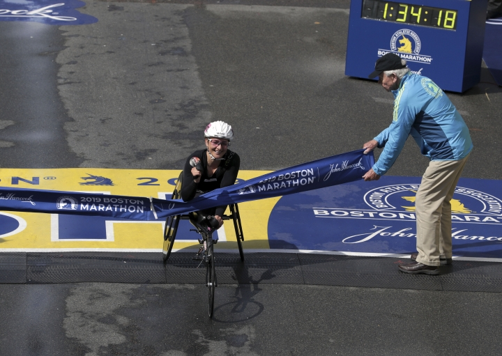 Manuela Schar, of Switzerland, breaks the tape to win the women's handcycle division of the 123rd Boston Marathon on Monday, April 15, 2019, in Boston. (AP Photo/Charles Krupa)