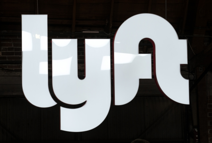 File- This photo taken March 29, 2019, shows a sign for Lyft in Los Angeles. Lyft has pulled 3,000 electric bikes from the streets of New York, San Francisco and Washington, D.C., after customers complained the bikes were braking too hard. A spokeswoman with the ride-hailing company said Monday, April 15, 2019, they are aware of reports of injuries, but wouldn't specify the number of complaints it received. On Twitter, riders complained of being thrown over the handlebars. (AP Photo/Ringo H.W. Chiu, File)
