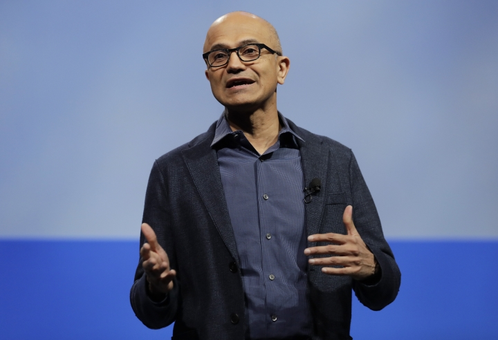 """File-This Nov. 28, 2018, file photo shows Microsoft CEO Satya Nadella speaking during the annual Microsoft Corp. shareholders meeting in Bellevue, Wash. Microsoft is revamping its practices for investigating workplace investigations after a group of women shared stories of discrimination and sexual harassment. Nadella sent a letter to employees about the changes Monday, April 15, 2019. Nadella says the company is increasing support services for workers who say they've experienced misbehavior, including a new """"Employee Advocacy Team"""" to help guide employees through investigations. (AP Photo/Ted S. Warren, File)"""