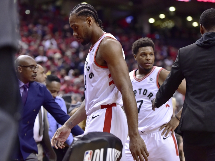Toronto Raptors forward Kawhi Leonard (2) walks off the court after the Orlando Magic defeated the Raptors 104-101 in Game 1 of a first-round NBA basketball playoff series in Toronto, Saturday, April 13, 2019. (Frank Gunn/The Canadian Press via AP)