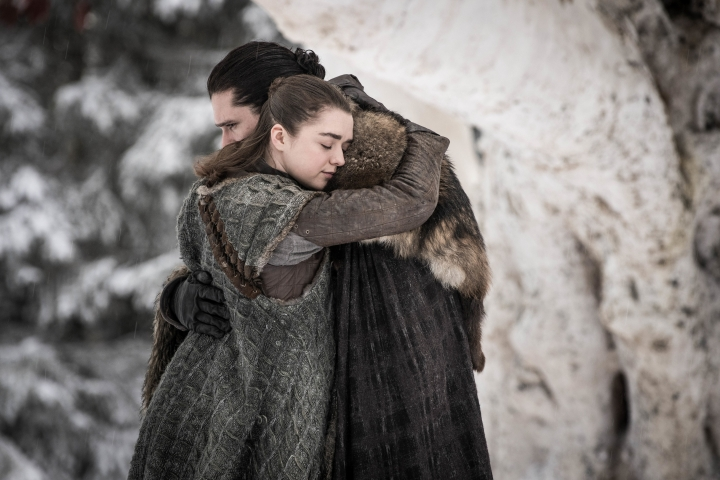"""This image released by HBO shows Maisie Williams, left, and Kit Harington in a scene from """"Game of Thrones,"""" premiering on Sunday, April 14. The first episode of the final season of """"Game of Thrones"""" is a record-breaker for the series and HBO. The pay channel said the 17.4 million viewers who watched Sunday's episode either on TV or online represent a season-opening high for the fantasy saga. (Helen Sloan/HBO via AP)"""