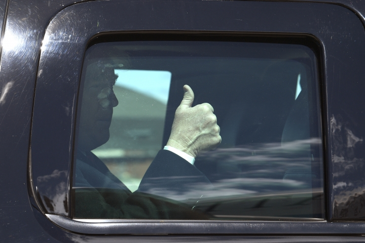 President Donald Trump gives thumbs up as his motorcade arrives near Air Force One at Andrews Air Force Base, Md., Monday, April 15, 2019. Trump is heading to Minnesota to tout the 2017 tax law. (AP Photo/Susan Walsh)