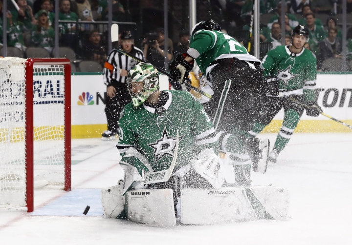 Dallas Stars goaltender Ben Bishop (30) looks back to see the puck shoot back out of the goal after Nashville Predators' cRocco Grimaldi's score in the second period of Game 3 in an NHL hockey first-round playoff series in Dallas, Monday, April 15, 2019. (AP Photo/Tony Gutierrez)