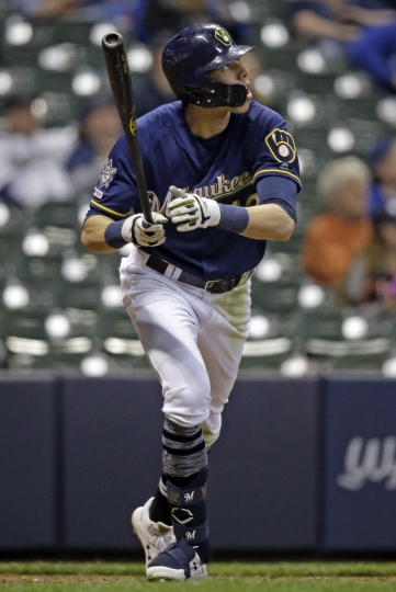 Milwaukee Brewers' Christian Yelich watches his home run against the St. Louis Cardinals during the eighth inning of a baseball game Monday, April 15, 2019, in Milwaukee. It was Yelich's third home run of the game. (AP Photo/Jeffrey Phelps)