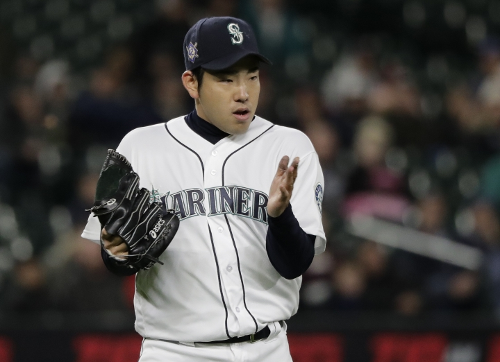 Seattle Mariners starting pitcher Yusei Kikuchi claps his glove at the end of the sixth inning of a baseball game against the Cleveland Indians, Monday, April 15, 2019, in Seattle. (AP Photo/Ted S. Warren)
