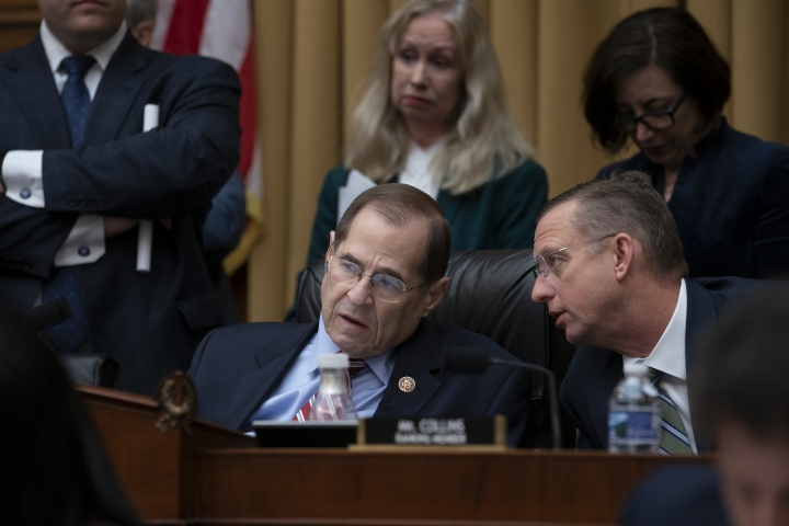 House Judiciary Committee Chair Jerrold Nadler, D-N.Y., joined at right by Ranking Member Doug Collins, R-Ga., confer before a resolution was passed to subpoena special counsel Robert Mueller's full report, on Capitol Hill in Washington, Wednesday, April 3, 2019. (AP Photo/J. Scott Applewhite)