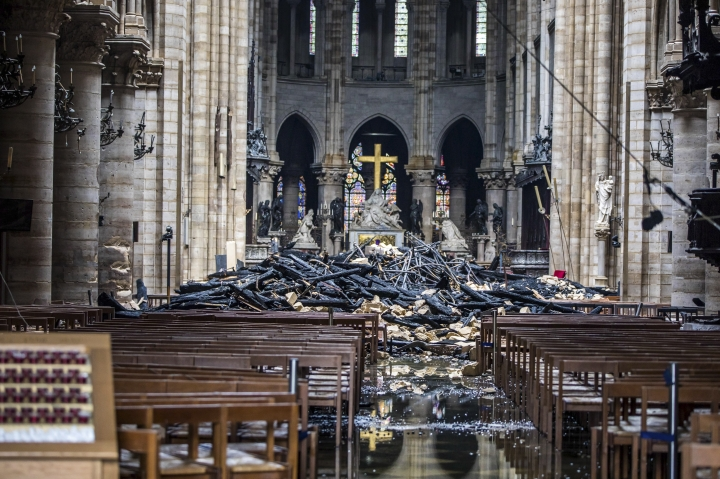 debris are seen inside the damaged Notre Dame cathedral in Paris, Tuesday, April 16, 2019. Firefighters declared success Tuesday in a more than 12-hour battle to extinguish an inferno engulfing Paris' iconic Notre Dame cathedral that claimed its spire and roof, but spared its bell towers and the purported Crown of Christ. (Christophe Petit Tesson, Pool via AP)
