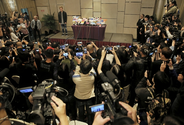 Hong Kong singer Andy Hui stands and let photographers take pictures before a press conference about his affair in Hong Kong, Tuesday, April 16, 2019. Hong Kong's Apple Daily newspaper published video that purported to show Andy Hui being intimate in a taxi with another Hong actress, decades younger than him, Jacqueline Wong. (AP Photo/Vincent Yu)