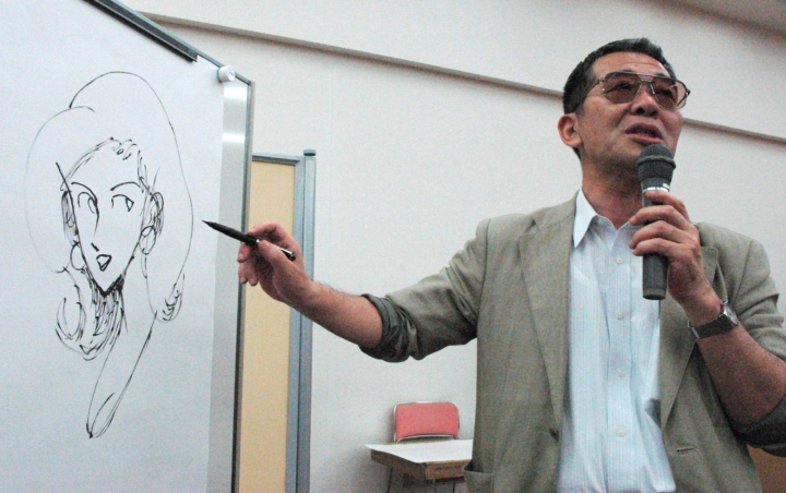 This June, 2004, photo shows cartoonist Monkey Punch drawing his character Fujiko Mine on whiteboard at a symposium in Nishinomiya, western Japan. Monkey Punch, best known as the creator of a Japanese megahit comic series of master thief Lupin The Third, has died at age of 81. His office, MP Pictures, said Wednesday, April 17, 2019, that Monkey Punch, whose real name is Kazuhiko Kato, died of pneumonia on April 11.(Kyodo News via AP)