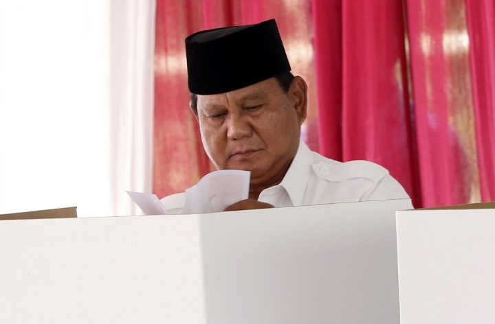 Indonesian presidential candidate Prabowo Subianto casts his ballot during the presidential election at a polling station in Bogor, Indonesia, Wednesday, April 17, 2019. Voting is underway in Indonesia's presidential and legislative elections after a campaign that that pitted the moderate incumbent against an ultra-nationalist former general. (AP Photo/Achmad Ibrahim)