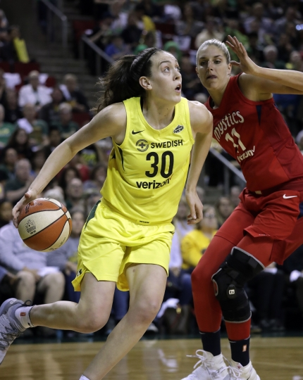 FILE - In this Sept. 7, 2018, file photo, Seattle Storm's Breanna Stewart (30) drives past Washington Mystics' Elena Delle Donne during the first half of Game 1 of the WNBA basketball finals, in Seattle. Reigning WNBA MVP Breanna Stewart is expected to miss the upcoming season after she ruptured the Achilles' tendon in her right leg. Stewart injured the leg on Sunday, April 14, 2019, in the EuroLeague Women championship game. She flew to Los Angeles where test results confirmed the injury. The Storm announced the diagnosis on Wednesday. (AP Photo/Elaine Thompson, File)