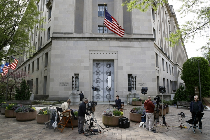 Television news crews work outside the Department of Justice building, Wednesday, April 17, 2019, in Washington. (AP Photo/Patrick Semansky)