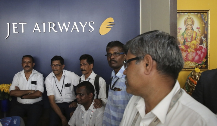 Employees of Jet Airways gather to demand clarification on unpaid salaries at the company headquarters in Mumbai, India Thursday, April 18, 2019. Jet Airways, once India's largest airline, announced on Wednesday that it is suspending all operations after failing to raise enough money to run its services. (AP Photo/Rafiq Maqbool)