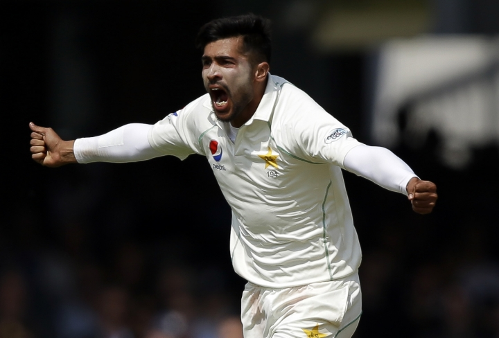 FILE - In this Saturday, May 26, 2018, file photo, Pakistan's Mohammad Amir celebrates during a first test cricket match at Lord's cricket ground in London. Pakistan has dropped out-of-form fast bowler Amir and included 18-year-old paceman Mohammad Hasnain in its 15-member World Cup squad. Amir's exclusion came after the left-armer took only five wickets in 14 ODIs since Pakistan won the Champions Trophy in 2017. (AP Photo/Alastair Grant, File)