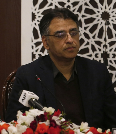 "FILE - In this Tuesday, Feb. 26, 2019 file photo, Pakistan's Finance Minister Asad Umar attend a meeting in Islamabad, Pakistan. Pakistan's finance minister says he will step down amid a wave of criticism over the government's handling of a financial crisis that has sent prices soaring. Umar tweeted Thursday, April 18, 2019 that Prime Minister Imran Khan offered him the energy portfolio in the Cabinet but he refused. He defended Khan's leadership, calling him the ""best hope"" for Pakistan.(AP Photo/Anjum Naveed, File)"