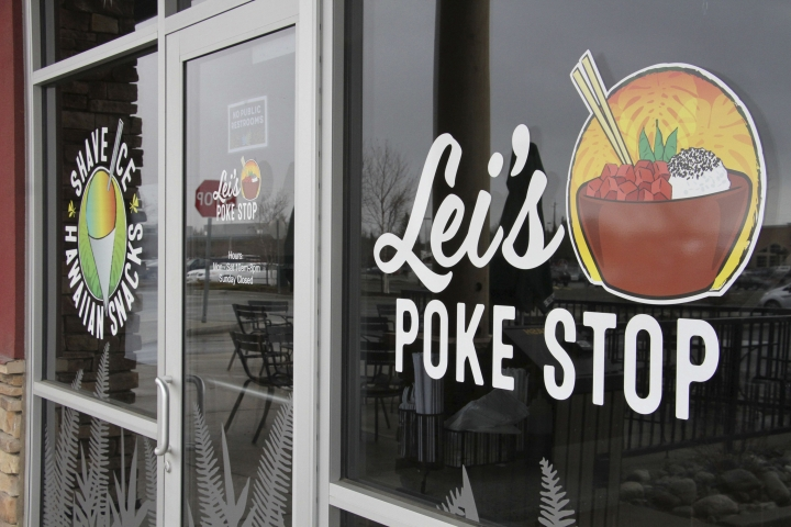 "The exterior of Lei's Poke Stop is seen Wednesday, April 17, 2019, in Anchorage, Alaska. Hawaii lawmakers are considering adopting a resolution calling for the creation of legal protections for Native Hawaiian cultural intellectual property. The move comes after a Chicago restaurant chain owner shocked the island state by trademarking the name ""Aloha Poke"" and sending letters to similarly named cubed fish shops around the country demanding that they change their names, including this Anchorage store, which changed its name. (AP Photo/Mark Thiessen)"