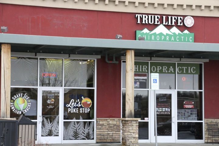 """The exterior of Lei's Poke Stop, at left, is seen Wednesday, April 17, 2019, in Anchorage, Alaska. Hawaii lawmakers are considering adopting a resolution calling for the creation of legal protections for Native Hawaiian cultural intellectual property. The move comes after a Chicago restaurant chain owner shocked the island state by trademarking the name """"Aloha Poke"""" and sending letters to similarly named cubed fish shops around the country demanding that they change their names, including this Anchorage store, which changed its name. (AP Photo/Mark Thiessen)"""