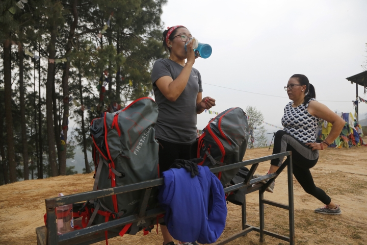 In this photo taken Saturday, March 30, 2019, Nima Doma, 34, left, and Furdiki Sherpa, 43, perform morning exercises as they train to summit Mount Everest, in Kathmandu, Nepal. Five years after one of the deadliest disasters on Mount Everest, three people from Nepal's ethnic Sherpa community, including Doma and Sherpa, are preparing an ascent to raise awareness about the Nepalese mountain guides who make it possible for hundreds of foreign climbers to scale the mountain and survive. The two women lost their husbands in the 2014 ice avalanche on Everest's western shoulder that killed 16 fellow Sherpa guides. (AP Photo/Niranjan Shrestha)