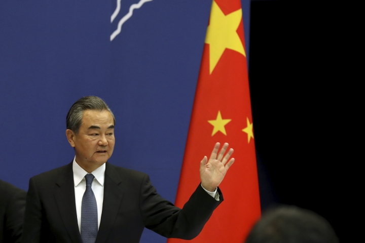 Chinese Foreign Minister Wang Yi waves as he leaves after a press conference on the upcoming Road and Belt Forum in Beijing on Friday, April 19, 2019. China is downplaying the political implications of its global development campaign known as the Belt and Road initiative, saying that it aims to boost multilateralism amid protectionist trends in the U.S. and elsewhere. (AP Photo/Ng Han Guan)