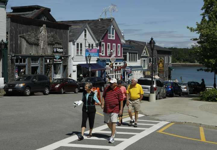 FILE-In this June 4, 2010 file photo, tourists stroll through Bar Harbor, Maine. The town plans to begin charging to park next month, eliminate all-day free parking on downtown side streets. The move comes amid ever-increasing seasonal traffic to Bar Harbor and Acadia National Park, which set a visitation record in 2018.(AP Photo/Robert F. Bukaty, file)
