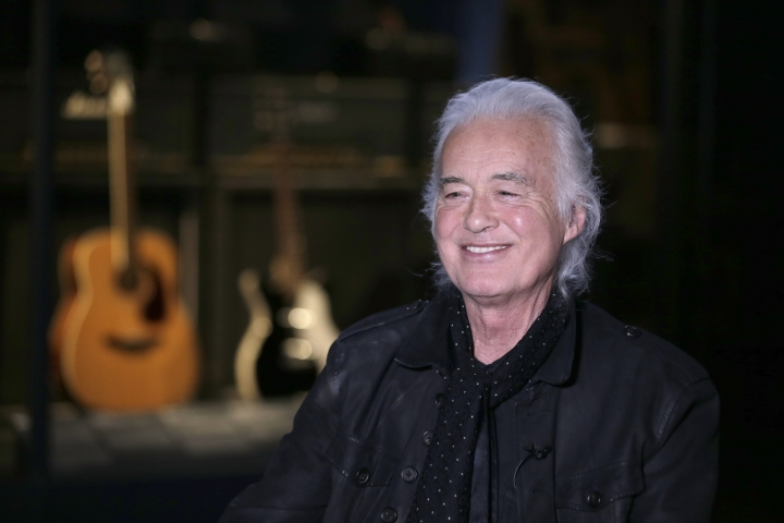 "Jimmy Page speaks to a reporter at the Metropolitan Museum of Art in New York, Monday, April 1, 2019. Some of the instruments that Page used to create his Led Zeppelin sound are on display an exhibition called ""Play It Loud: Instruments of Rock & Roll"" at the Metropolitan Museum of Art in New York. (AP Photo/Seth Wenig)"