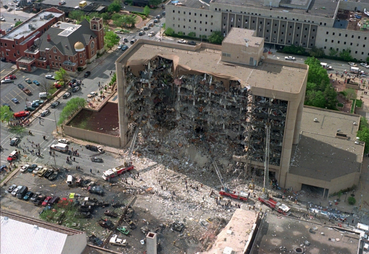 FILE - In this April 19, 1995, aerial file photo, the north side of the Alfred P. Murrah Federal Building in Oklahoma City is pictured after an explosion that killed 168 people and injured hundreds. As part of the city's annual day of remembrance Friday, April 19, 2019, – the 24th anniversary of the attack – civic leaders will plant a tree that was cloned from the Survivor Tree - a scarred American elm that survived the deadliest act of domestic terrorism on U.S. soil. (AP Photo/File)