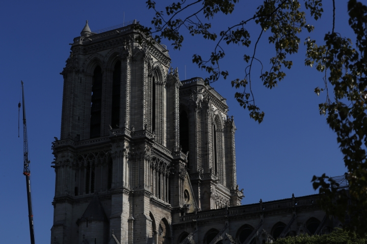 Notre Dame cathedral is pictured, Friday, April 19, 2019, in Paris. Rebuilding Notre Dame, the 800-year-old Paris cathedral devastated by fire this week, will cost billions of dollars as architects, historians and artisans work to preserve the medieval landmark. (AP Photo/Thibault Camus)