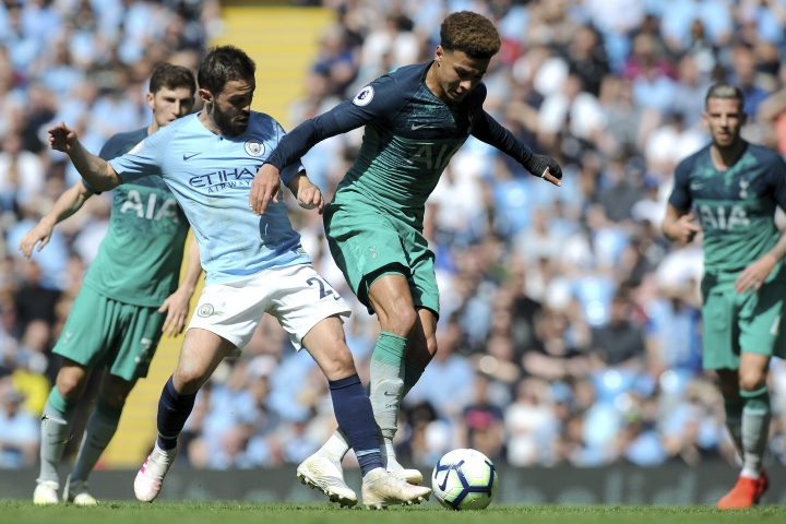 Tottenham's Dele Alli, center right, fights for the ball with Manchester City's Bernardo Silva during the English Premier League soccer match between Manchester City and Tottenham Hotspur at Etihad stadium in Manchester, England, Saturday, April 20, 2019. (AP Photo/Rui Vieira)