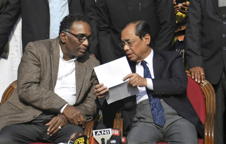 FILE - In this Jan. 12, 2018 file photo, Indian Supreme Court judge Justice Ranjan Gogoi, right, speaks with Justice Jasti Chelameswar as they address the media in New Delhi, India. A former employee of India's Supreme Court has accused Gogoi, now the country's chief justice, of sexual harassment, an accusation that was vehemently denied by the judge, reports said Saturday, April 20, 2019. (AP Photo/File)