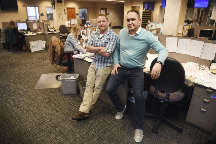 In this April 9, 2019, photo, Argus Leader investigative reporter Jonathan Ellis and news director Cory Myers in the newsroom in Sioux Falls, S.D. In 2010, reporters at South Dakota's Argus Leader newspaper came up with the idea of requesting data about the government's food assistance program. They thought the information about the $65-billion dollar-a year program, previously known as food stamps, could lead to a series of stories and help them identify possible fraud. But the government didn't provide everything the paper wanted. Trying to get the data has taken the paper more than eight years and landed the case at the Supreme Court. (Briana Sanchez/The Argus Leader via AP)