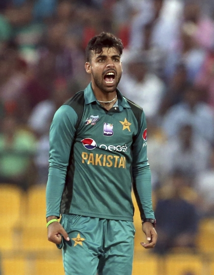 "FILE - In this Sept. 26, 2018 file photo, Pakistan's Shadab Khan celebrates the dismissal of Bangladesh's Imrul Kayes during the one day international cricket match of Asia Cup between Pakistan and Bangladesh in Abu Dhabi, United Arab Emirates. Khan has been ruled out of next month's one-day international series against England due to illness. The Pakistan Cricket Board says in a statement on Sunday, April 21, 2019 that ""tests revealed a virus that will require treatment and rest for, at least, four week."" (AP Photo/Aijaz Rahi, File)"